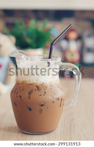 Mocha iced coffee on the table, vintage tone - stock photo