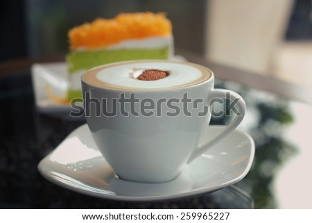 Mocha in white coffee cup and Foythong Cake or Gold Egg Yolks Thread Cake in the Coffee Shop, retro and vintage tone - stock photo
