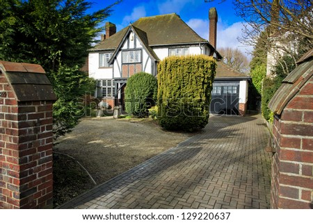 Mock Tudor house with drive in Swindon, UK - stock photo