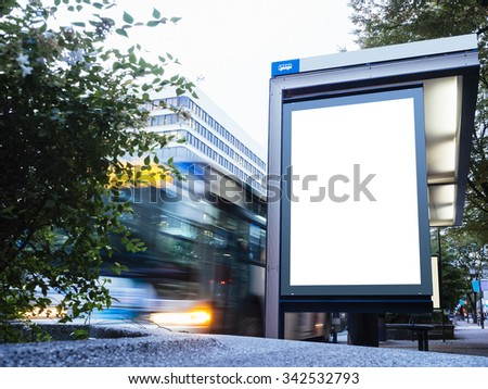 Mock up Billboard Light box at Bus Stop with Road and cars moving - stock photo
