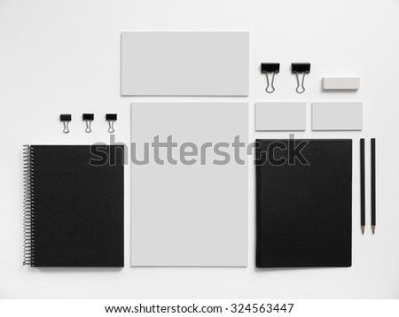 Mock-up brand template with business cards, envelopes and notepads. Isolated on white background. - stock photo