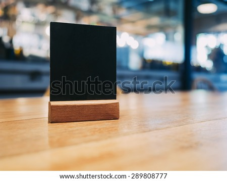 Mock up Menu frame on Table in Bar restaurant cafe - stock photo