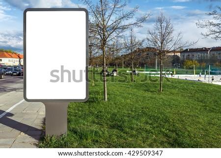 Mock up of blank street poster billboard on green grass - stock photo