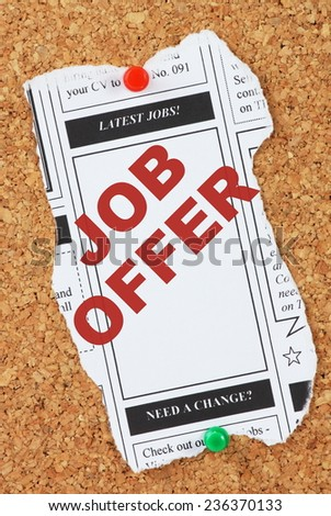 Mock up of the Latest Jobs from the classified ads section of a newspaper with the phrase Job Offer  in the column box - stock photo