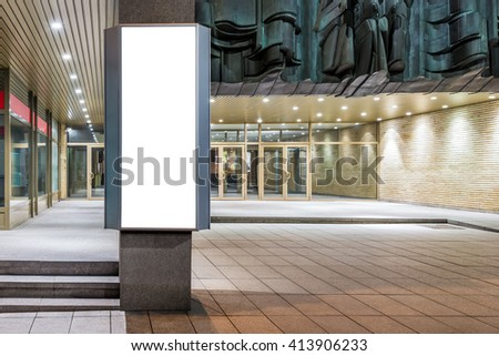 Mock up of vertical lightbox in city space at night - stock photo