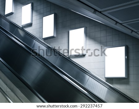 Mock up Poster media template Ads display in Subway station escalator - stock photo
