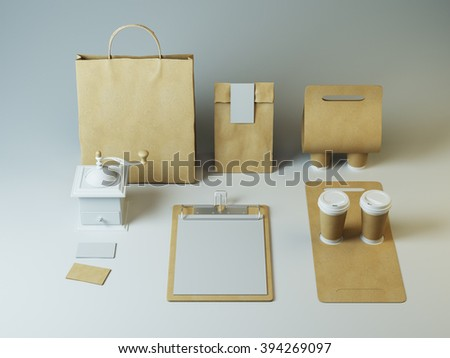 Mockup of craft packaging and cups with empty letter on clipboard. Hipster branding elements for restaurant - stock photo