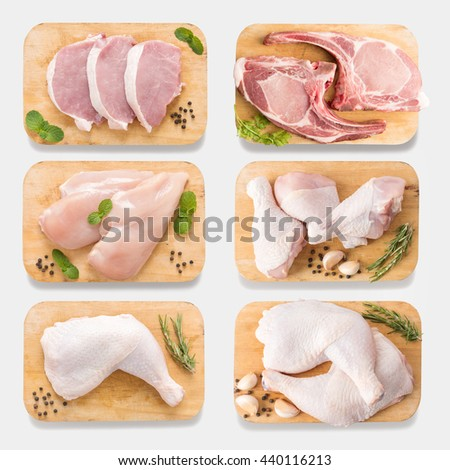 Mockup raw chicken and pork on cutting board set on  isolated on white background. Copy space for text and logo. Clipping Path included isolated on white background. - stock photo