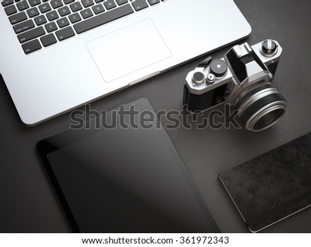 Mockup with computer, camera and tablet on black floor - stock photo