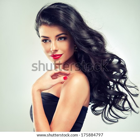 Model brunette with long curly hair - stock photo