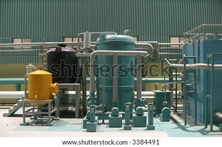 Model Factory -- partial view of a miniature production plant - stock photo