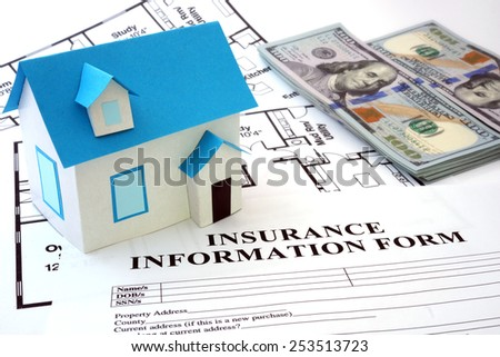 model house and insurance form with  dollars - stock photo