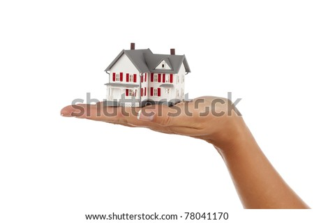 Model House in Female Hand Isolated on a White Background. - stock photo