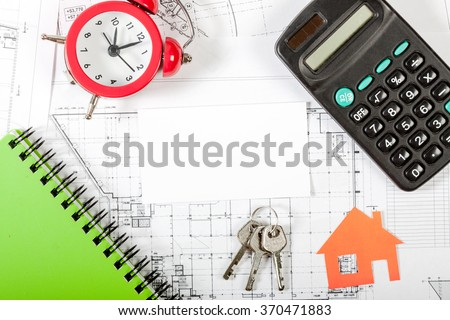Model house on construction plan for house building, keys, red alarm clock and calculator. With white blank business card. Real Estate Concept.  - stock photo