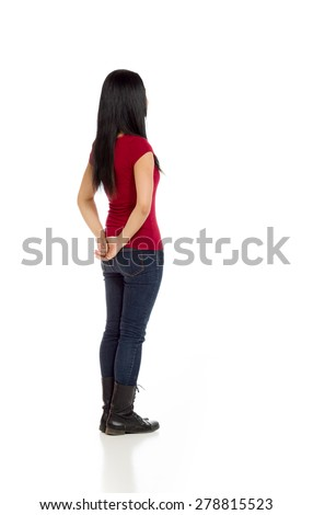 Model isolated on plain background in studio from behind - stock photo