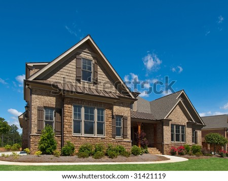 Model Luxury Home Exterior angle view with sidewalk - stock photo