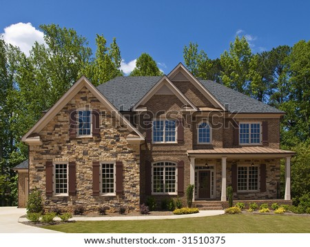 Model Luxury Home Exterior front view with porch - stock photo