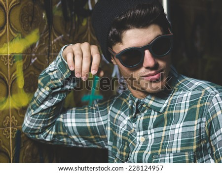 Model man portrait with sunglasses with flash light outdoors - stock photo
