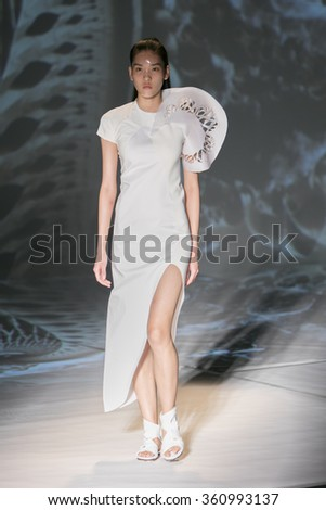 Model May Wu walks the runway at the Threeasfour fashion show during New York Fashion Week Spring Summer 2016 at Pier 59 on September 14, 2015 in New York City - stock photo