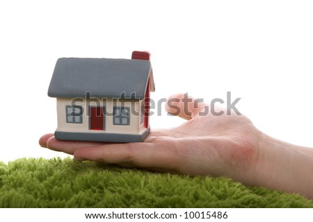 Model of a  house on hand - stock photo