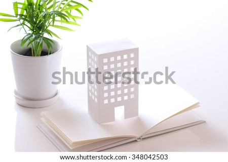 model of building on white book - stock photo