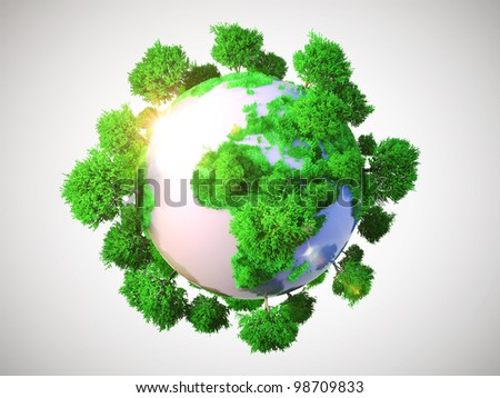 Model of Earth with oversized trees. Miniature planet with sparse leafy tree vegetation. Conceptual symbol of the Earth on a gray background. - stock photo