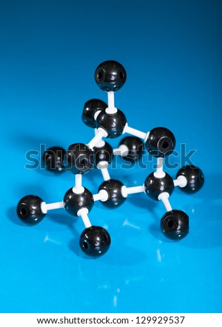 Model of graphite  molecular structure on blue reflective background - stock photo