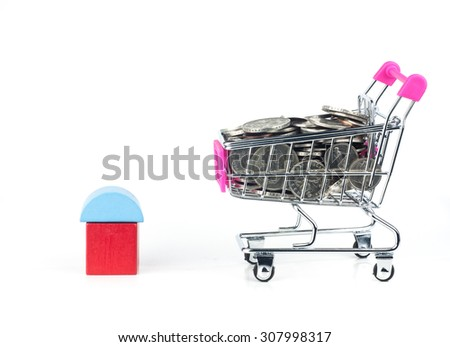 Model of house with coins on shopping cart or trolley - Financial concept - stock photo