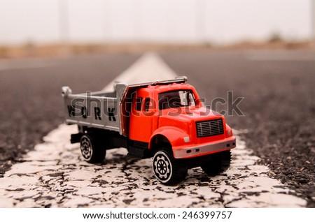 Model of the Truck on an Asphalt Road - stock photo