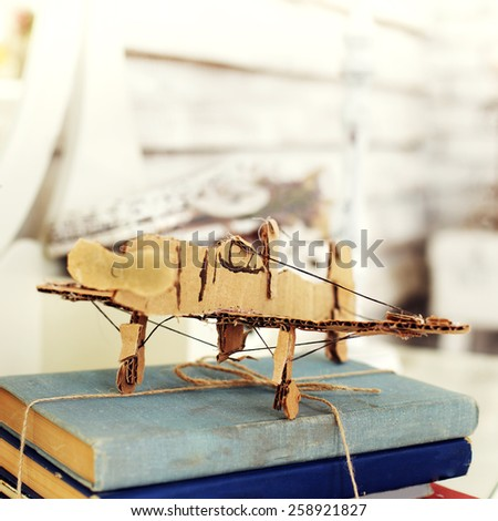 model paper airplane on book  - stock photo