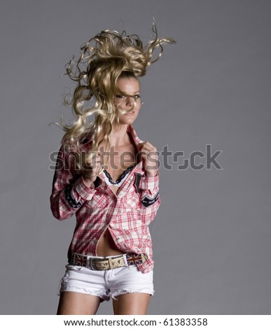 Model posing and working it flipping the hair... - stock photo