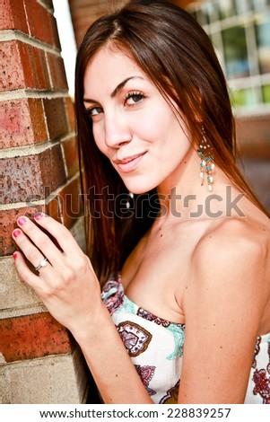 Model posing with brick - stock photo