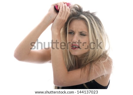 Model Released. Young Woman Brushing Tangled Hair - stock photo
