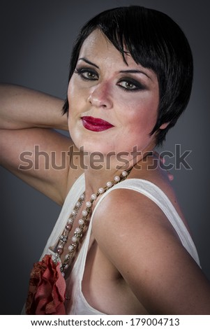 Model, Retro posing lady,  flapper dress, Girl dreaming beautiful young woman from roaring 20s looking at camera.  vintage twenties - stock photo