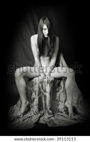 Model shot in the retro-vintage style - young naked women on black background - stock photo