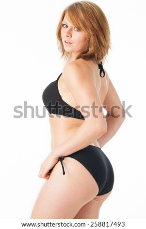 Model shows off her body profile - stock photo