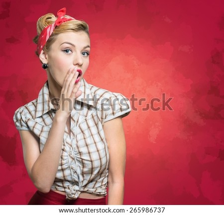 Model. Surprised woman with open mouth. Pinup girl. Beauty woman over red polka dots background. Emotions - stock photo