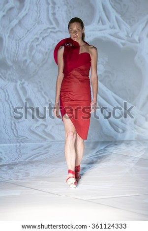 Model Taylor Foster walks the runway at the Threeasfour fashion show during New York Fashion Week Spring Summer 2016 at Pier 59 on September 14, 2015 in New York City - stock photo