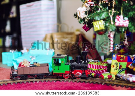 Model train with Christmas presents and tree - stock photo