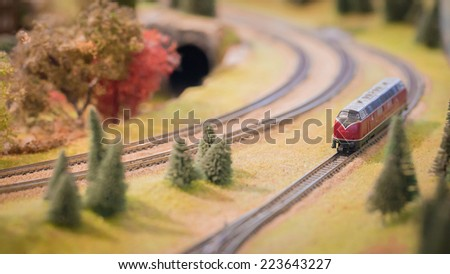 Model trains in an miniature goods yard,Red trains ,Autumn color - stock photo