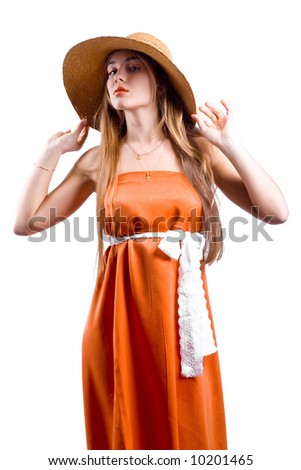Model with beautiful long hair posing in orange dress and hat isolated on white - stock photo