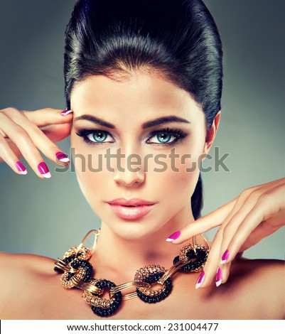 Model with long curly tail and fashionable necklaces - stock photo