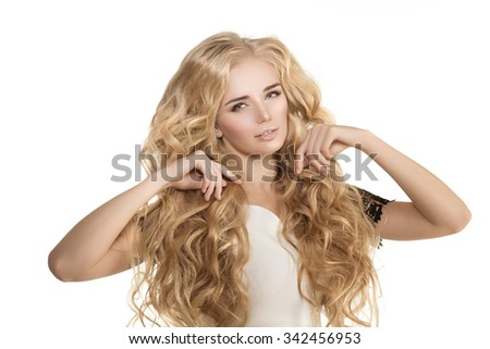 Model with long hair Blonde Waves Curls Hairstyle Hair Salon Updo Fashion model with shiny hair Woman with healthy hair girl with luxurious haircut Hair loss Girl with hair volume  - stock photo