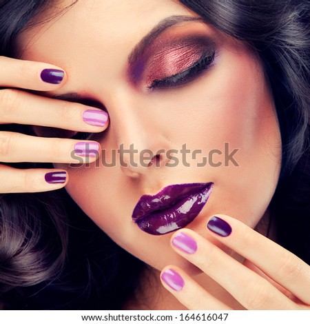 Model with purple makeup and curled hair - stock photo