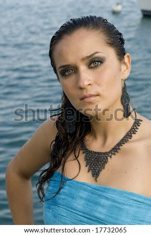 Model with strapless turquoise top with hand on hip - stock photo