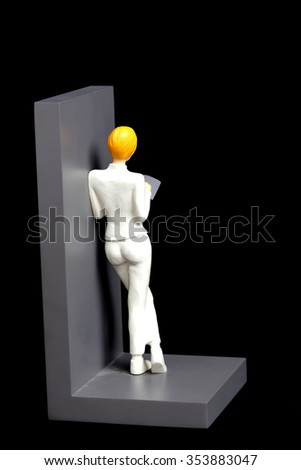 model woman standing reading in black background / Partition books - stock photo