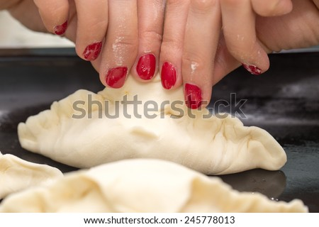 modeling dough pies - stock photo