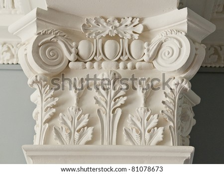 Modelled column on a building facade - stock photo