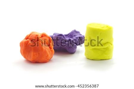 Modelling clay balls on white - stock photo