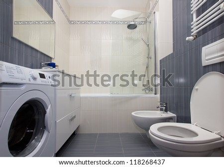 Moder luxury bathroom in gray and white tiles - stock photo